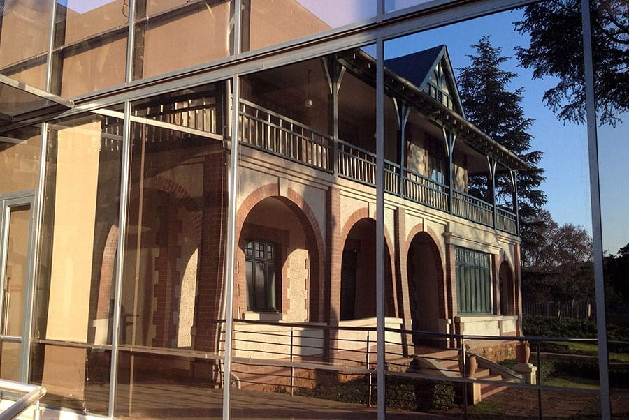 The historic Wanooka House, restored and redecorated, is mirrored on a modern façade of the new KPMG East Campus. (Picture: Stuart Cloete).